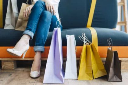 crop-woman-couch-near-paper-bags_23-2147786880